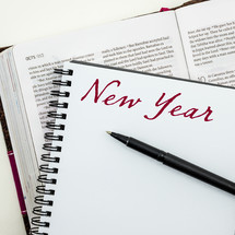 word New Years on a journal and Bible
