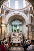 worship service in an ancient church in the holy land