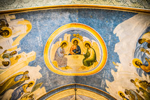 biblical paintings on a ceiling of an ancient church