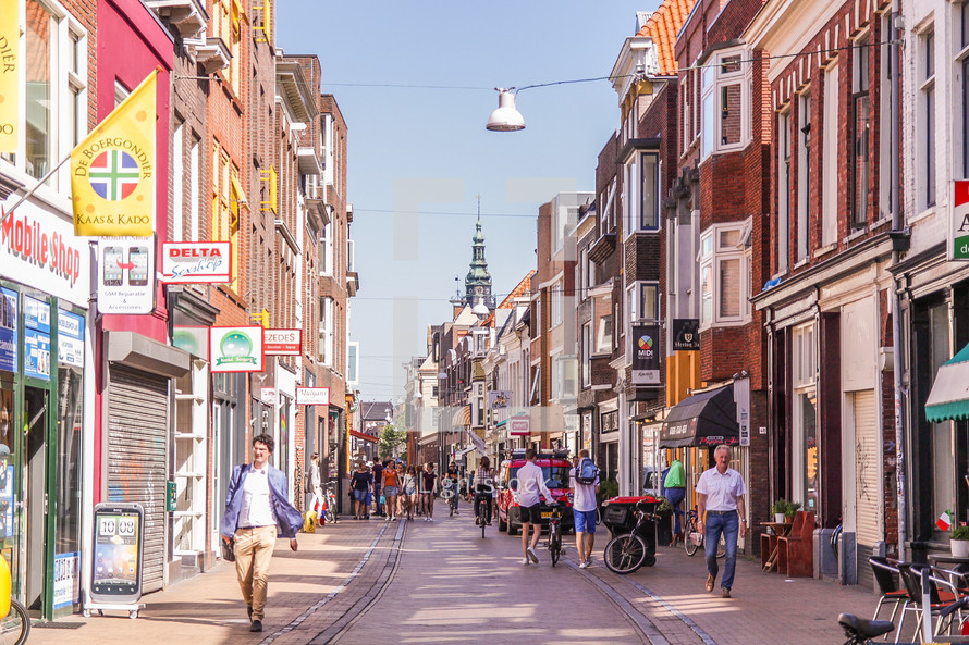 people walking on a narrow street in the Netherlands