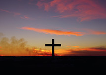 silhouette of a cross at sunrise