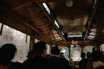 wedding guests on a trolley bus