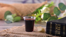 Taking communion concept - the wine and the bread symbols of Jesus Christ blood and body. Easter Passover and Lord Supper concept. Dolly shot 4k