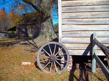 autumn farm and wagon wheel at a ranch in Rural Virginia during the  fall season.