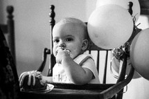 a baby eating birthday cake