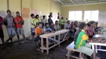 men listening to a worship service in Papua New Guinea