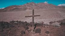 cross in a desert mountain landscape