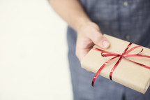 Hand holding a Christmas gift.