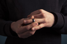 a man taking off his wedding ring