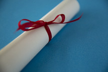 rolled up diploma