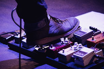 foot on a guitar pedal