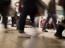 feet of shoppers in a mall