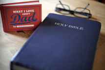 What I love about dad book, Bible, and glasses on a table