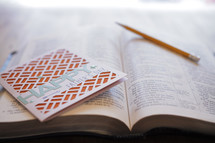 Father's day card and pencil on an open Bible