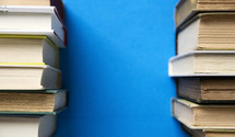 stacked books on blue background.