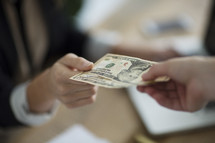 cash exchanging hands.