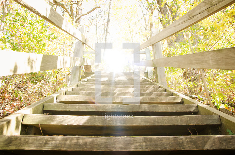 Sun shining on wooden stairway