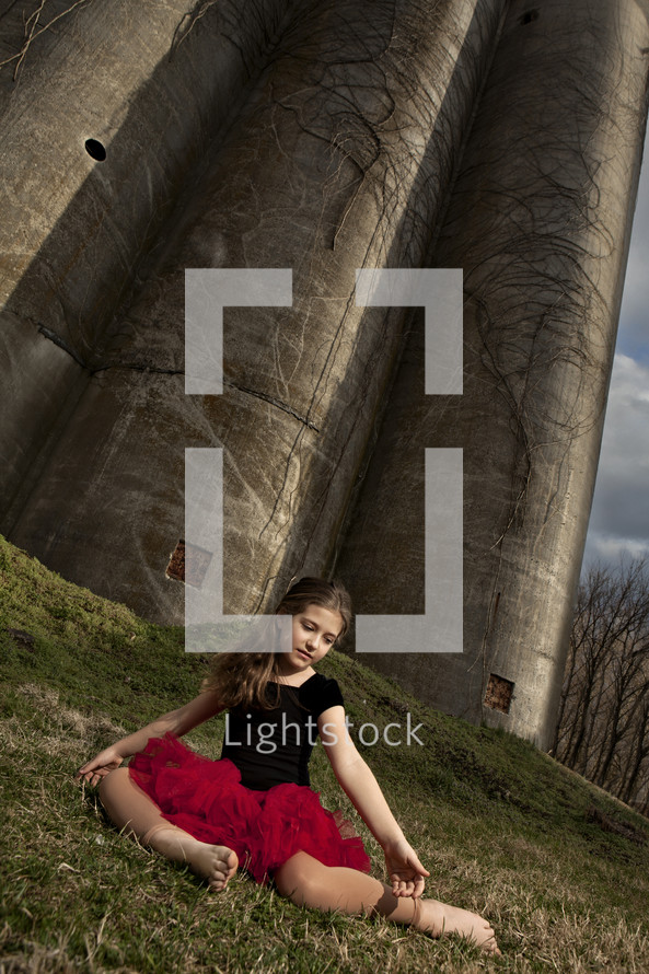 ballerina girl sitting in front of an old castle