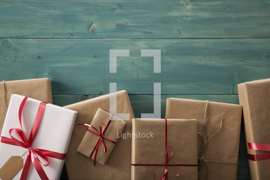 border of wrapped gifts on a wood floor