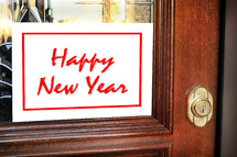 Happy New Year sign on a door