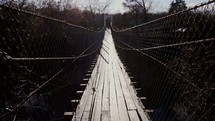 crossing a swinging bridge