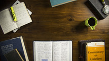 Someone preparing a desk to begin studying their Bible.