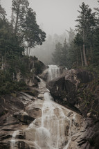 smoke from wildfires gives extra moody look to this rugged waterfall
