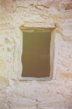 window on ruins in a mountainside
