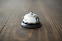 bell on a wood floor