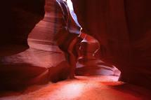 sunlight shining onto a canyon floor