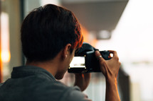 A man looking into a video camera.