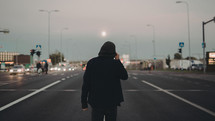 a man standing in the middle of a highway