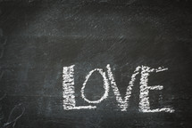 word love in chalk on slate