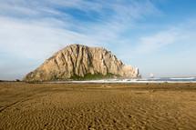 sandy beach and mountain peak