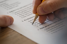 student taking a multiple choice test