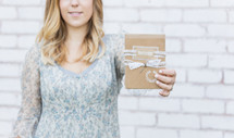 woman holding a greeting card