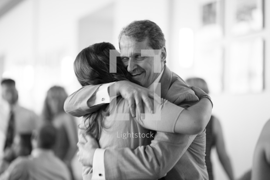 Father and daughter embracing.