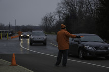 event staff directing traffic