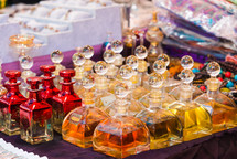 Arabian perfumes in  bottles at market. oil and rose flowers aromatherapy spa perfumery.