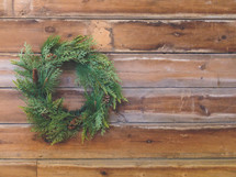 Christmas pine wreath on farmhouse wood background