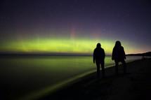 Aurora Borealis and silhouettes