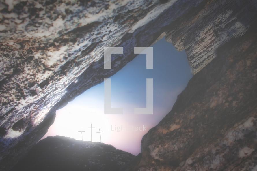 view of three crosses through cracks in rocks
