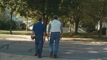 men walking carrying Bibles