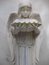The Guardian of the eternal - An Angel statue of a chid angel holding an oyster shell adoring a grave marker. Heaven, Angels eternity.