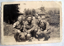 A vintage photograph of three US Army Soldiers including an Army Medic and his two pals stationed over in Normandy, France during World War II around 1942- 1944.