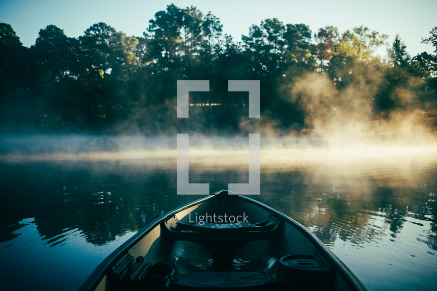 boat on a steaming pond