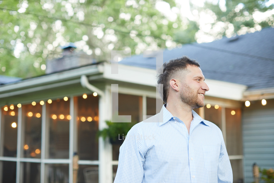 a man standing in a back yard