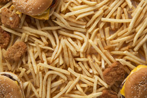 hamburger, french fries, and chicken nuggets background.
