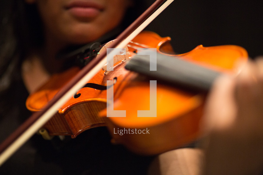 playing a violin