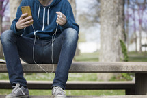 a man listening to a podcast outdoors